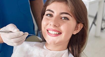 woman wearing pink lipstick smiling